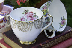 China Tea Cup. A china tea cups on vintage floral background Stock Photo