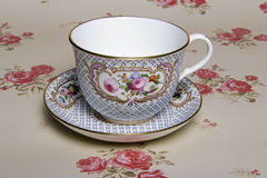 China Tea Cup. A china tea cup and tiara on vintage floral background Stock Photos