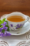 China tea cup with violets. China tea cup with  violets Royalty Free Stock Image