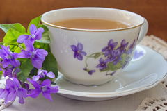 China tea cup with violets Royalty Free Stock Photos