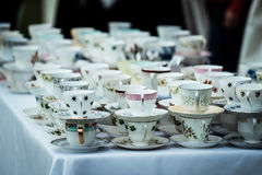 China tea cups. A table full of china tea cups with blurred background Stock Images