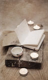 China tea, notebook, candles. Artwork in vintage style, china tea, notebook, candles Royalty Free Stock Images