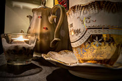 China tea pot, candle and cup Royalty Free Stock Photo