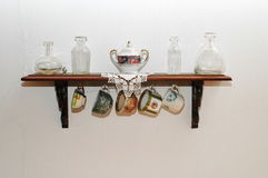 China tea shelf. Old tableware on a very old wood shelf Royalty Free Stock Images