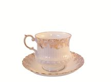 China Teacup. White and gold china tea cup and saucer Royalty Free Stock Photos
