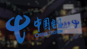 China Telecom logo on the glass against blurred business center. Editorial 3D rendering Royalty Free Stock Photo
