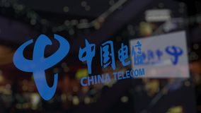China Telecom logo on the glass against blurred business center. Editorial 3D rendering