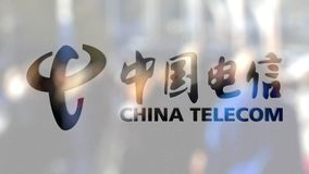 China Telecom logo on a glass against blurred crowd on the steet. Editorial 3D rendering. China Telecom logo on a glass against blurred crowd on the steet Royalty Free Stock Photography