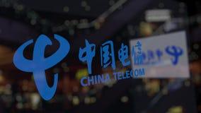 China Telecom logo na szkle przeciw zamazanemu centrum biznesu Redakcyjny 3D rendering Zdjęcie Royalty Free