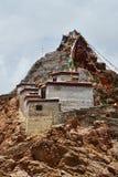 China, Tibet, Chiu Gompa monastery on a hill on the shore of lake Manasa.  royalty free stock photos
