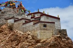 China, Tibet, Chiu Gompa monastery on a hill on the shore of lake Manasarovar.  stock photo