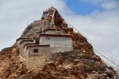 China, Tibet, Chiu Gompa monastery on a hill on the shore of lake Manasarovar.  stock image