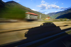 Autumn Aspens and Highway. China Tibet a road autumn scenery in October stock photo