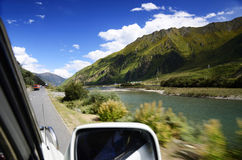 Autumn Aspens and Highway. China Tibet a road autumn scenery in October royalty free stock photo