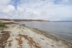 China, Tibet, the sacred lake for Buddhists Manasarovar in june in cloudy weather.  stock image