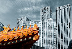 China today. An ancient eave is in front of CBD building Stock Photo
