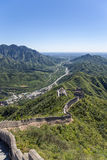 China. Top view of a fragment of the Great Wall of China. On the horizon, Beijing Royalty Free Stock Image