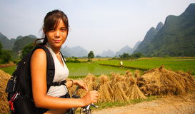 China tourist. Young woman on bike in Yangshuo, China royalty free stock photos