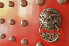 China Town. Red Door Guardian Brass Handle stock photo