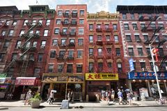 China town, NYC. Facades of house and shops in China town on August 23, 2017 in New York City, NY. Manhattan is the most densely populated borough of New York royalty free stock images