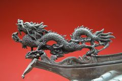 China Town Temple Dragon. An oriental dragon found in china town with red background Royalty Free Stock Images
