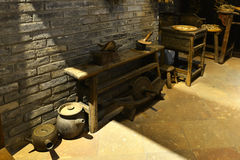 China traditional medicine store or old Chinese pharmacy. Pottery used to boil herbs,hay cutter used to cut herbal medicine, crusher,ancient medical culture of royalty free stock photography