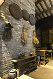 China traditional medicine store or old Chinese pharmacy. Pottery used to boil herbs, hay cutter used to cut herbal medicine, crusher, ancient medical culture of stock images