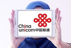 China Unicom company logo. Logo of China Unicom company on samsung tablet holded by arab muslim woman. China Unicom is a Chinese state-owned telecommunications Royalty Free Stock Photo