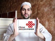 China Unicom company logo. Logo of China Unicom company on samsung tablet holded by arab muslim man. China Unicom is a Chinese state-owned telecommunications Royalty Free Stock Photography