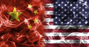 China and USA smoke flag. Isolated on a black background stock image