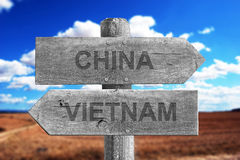 China and Vietnam border signal. Made of wood outdoor stock image