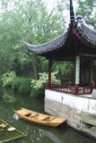 China village. A boat and temple in a chinese garden, asia Stock Photo