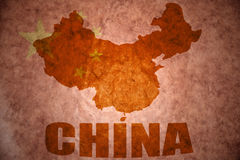 China vintage map. China map on a vintage chinese flag background stock photography
