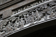 China wood carving. North China wood carving detail on the door beams of a house stock photo