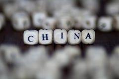 China-Wort mit hölzernen Würfeln Stockfotos