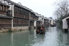 China ,wuzhen Water Village,People row a boat Royalty Free Stock Photo