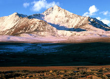 China/Xinjiang: snow mountain in sunrise. We have hiked from Baihaba village to Jiadengyu for seven days and more than 100km, passed through kanas, black lake Stock Photo