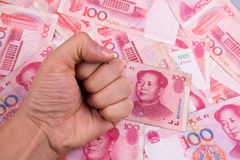 China Yuan. One hand on the China Yuan Stock Images
