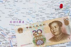China and Yuan. In a world atlas map royalty free stock photo