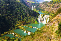 China Yunnan Luoping Kowloon falls group. Is a national AAAA level scenic spot, is located in Luoping County, 30 kilometers north of the city. Because of the stock photo