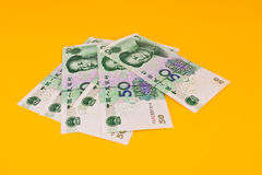 Chinaese 50 Yuan banknotes on yellow background Stock Photo