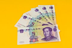 Chinaese 5 Yuan banknotes on yellow background Stock Images