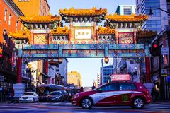 Chinatown arch. Friendship arch in Chinatown Washington DC District of Columbia sunset time golden colors fun walk in winter cold situation taxi red tab cool fun Stock Photo