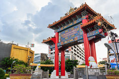 Chinatown arch marks. Bangkok, Thailand - October 11: Chinatown arch marks the beginning of famous Yaowarat Road on October 11, 2014 in Bangkok, Thailand Royalty Free Stock Images