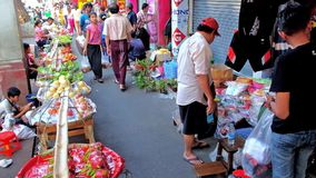 Chinatown food market in Yangon, Myanmar. YANGON, MYANMAR - FEBRUARY 14, 2018: The narrow walkway of Maha Bandula avenue in Chinatown is occupied with chaotic stock footage