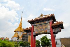 Chinatown gate with Wat Traimit temple, Bangkok Stock Images