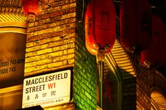 Street signage on red brick wall at night Red lantern in Chinatown London chinese new year stock image