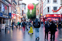 Chinatown in London. People stroll in Chinatown in London on October 10, 2013. With tens of restaurants, shops and bars, Chinatown is a popular touristic and Stock Images
