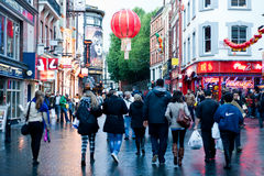 Chinatown in London. People stroll in Chinatown in London on October 10, 2013. With tens of restaurants, shops and bars, Chinatown is a popular touristic and Stock Photos