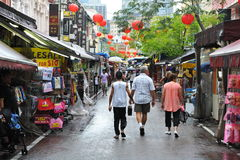 Chinatown Market in Singapore. Shoppers walk along a street in Chinatown district on May 10, 2013 in Singapore. Now a popular tourist landmark, ethnic Chinese Stock Photo
